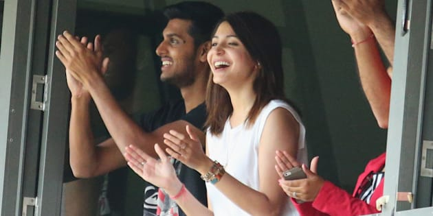 MELBOURNE, AUSTRALIA - DECEMBER 28:  Anushka Sharma, girlfriend of Virat Kohli smiles as Kohli celebrates after reaching his century during day three of the Third Test match between Australia and India at Melbourne Cricket Ground on December 28, 2014 in Melbourne, Australia.  (Photo by Scott Barbour/Getty Images)