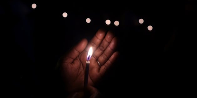 An Indian demonstrator holds a candle as she takes part in a vigil and silent protest against the alleged gang-rape of a nun in the eastern state of West Bengal, and attacks on Churches in Pakistan and India, in New Delhi on March 16, 2015. Hundreds of priests, school girls and other protesters staged a peaceful rally March 16, 2015 in the Indian city of Kolkata to support an elderly nun who was gang-raped at her convent school. AFP PHOTO/ SAJJAD HUSSAIN        (Photo credit should read SAJJAD HUSSAIN/AFP/Getty Images)