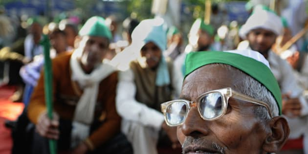 NEW DELHI, INDIA - MARCH 18: Farmers gathered under the banner of various farmer unions affiliated to India Coordination Committee of Farmers Movement to protest against the Land Acquisition bill at Jantar Mantar on March 18, 2015 in New Delhi, India.  Farmers organisations, including BKU demanded that Centre must take assent of 100 per cent farmers before land acquisition and the same should be done only for publicpurposes. (Photo by Subrata Biswas/Hindustan Times via Getty Images)