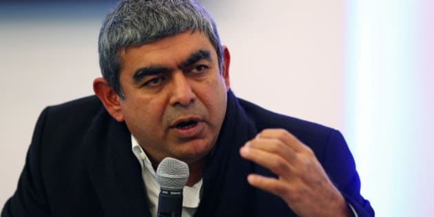 Vishal Sikka, chief executive officer of Infosys Ltd., gestures as he speaks during a session on the opening day of the World Economic Forum (WEF) in Davos, Switzerland, on Wednesday, Jan. 21, 2015. World leaders, influential executives, bankers and policy makers attend the 45th annual meeting of the World Economic Forum in Davos from Jan. 21-24. Photographer: Jason Alden/Bloomberg via Getty Images