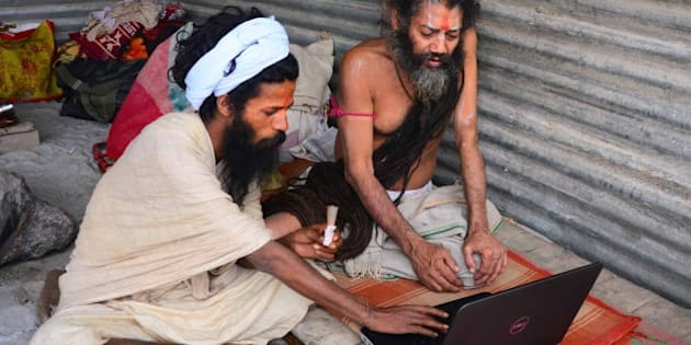 ALLAHABAD, INDIA - 2015/01/04: Sadhus working on laptop in their tent at the bank of Sangam during Magh Mela festival in Allahabad. (Photo by Prabhat Kumar Verma/Pacific Press/LightRocket via Getty Images)