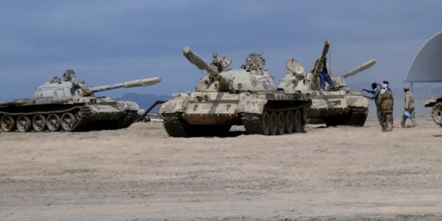 In this photo taken Tuesday, March 24, 2015, tanks seized recently by militiamen loyal to Yemen's President Abed Rabbo Mansour Hadi take positions at the al-Anad air base in the southern province of Lahej, 60 kilometers (35 miles) north of Aden, Yemen. Hadi fled the country by sea Wednesday on a boat from Aden, as Shiite rebels and their allies advanced on the southern port city of Aden, where he had taken refuge, captured his defense minister and seized the city's airport. (AP Photo/Wael Qubady)