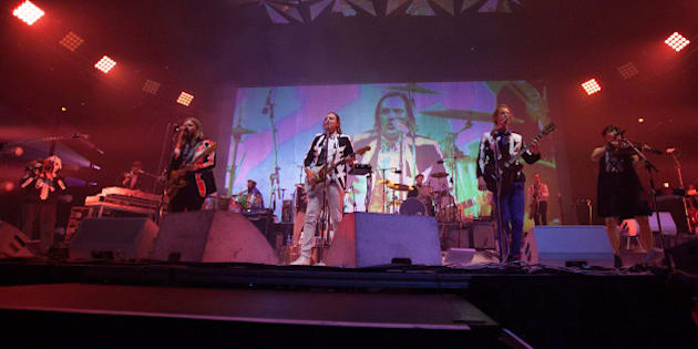 CHICAGO, IL - AUGUST 26:  Arcade Fire perform at United Center on August 26, 2014 in Chicago, Illinois.  (Photo by Gabriel Grams/Getty Images)