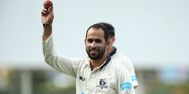 HOBART, AUSTRALIA - MARCH 22:  Fawad Ahmed of Victoria walks off holding the ball up high after taking eight wickets during day two of the Sheffield Shield final match between Victoria and Western Australia at Blundstone Arena on March 22, 2015 in Hobart, Australia.  (Photo by Robert Prezioso/Getty Images)