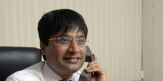 INDIA - JUNE 01:  VSS Mani, founder and managing director of JustDial, an online and telephone search engine, poses at office, Mumbai, India. Potrait, Sitting  (Photo by Rachit Goswami/The India Today Group/Getty Images)