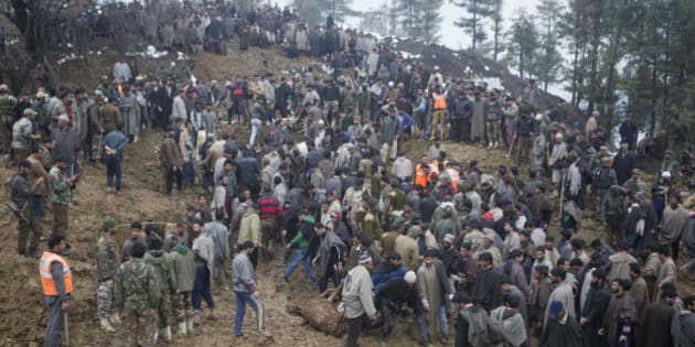 Kashmiri villagers and officials search for bodies of victims following landslides due to heavy rainfall in the village of Laden some 45 Kilometers (28 miles) west of Srinagar, Indian-controlled Kashmir, Monday, March 30, 2015. Hundreds of Kashmiris in both India and Pakistan moved to higher ground Monday as rain-swollen rivers swamped parts of the disputed Himalayan region placed under an emergency flood alert just six months after some 600 people died in flooding that left the region in shambles. (AP Photo/Dar Yasin)