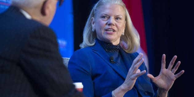 Virginia 'Ginni' Rometty, chief executive officer of International Business Machines Corp. (IBM), speaks to David Rubenstein, co-chief executive officer of Carlyle Group LP, left, during an Economic Club of Washington breakfast discussion in Washington, D.C., U.S., on Wednesday, Dec. 3, 2014. IBM, under pressure to reverse declining profit, is racing to sign up new cloud-related business as it tries to prove to investors that it can quickly transition to a new era of technology. Photographer: Andrew Harrer/Bloomberg via Getty Images