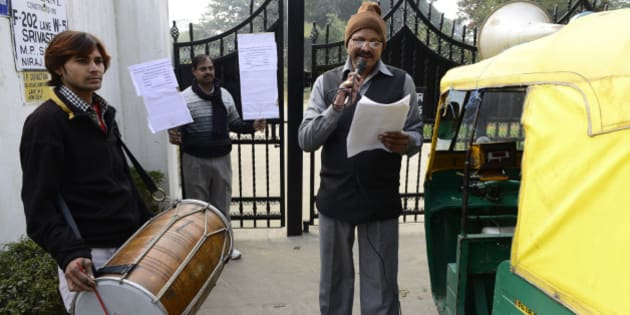 NEW DELHI, INDIA - JANUARY 02: MCD drum beaters outside the home of a tax defaulter in Sainik Farms on Wednesday. (Photo by K Asif/India Today Group/Getty Images)