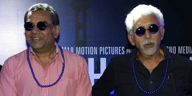 Indian Bollywood actors (L/R) Paresh Rawal and Nasseruddin Shah look on during the trailer launch of their upcoming Hindi film Dharam Sankat Mein in Mumbai on March 7, 2015.    AFP PHOTO        (Photo credit should read STR/AFP/Getty Images)