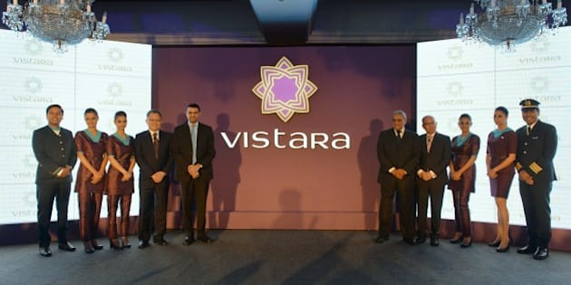 Staff members of TATA SIA Airlines Limited (TSAL) pose during the launch of the new brand name 'Vistara' -  Sanskrit word denoting limitless expanse  - for the new airline in New Delhi on August 11, 2014.  Tata Group and Singapore Airlines, which partnered to launch a full-service airline in the country, plans to launch services in October 2014.  AFP PHOTO/Chandan Khanna        (Photo credit should read Chandan Khanna/AFP/Getty Images)
