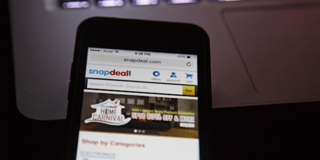 The Snapdeal.com website is displayed on an Apple Inc. Iphone in an arranged photograph in New Delhi, India, on Thursday, Aug. 21, 2014. India doesnt allow foreign-controlled companies to sell products online. Thats led local web retailers such as the local Snapdeal to a different model than the one pioneered by Amazon: they operate online marketplaces and local traders sell goods in a $3 billion e-commerce market. Photographer: Kuni Takahashi/Bloomberg via Getty Images