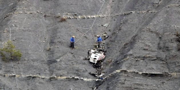 Rescue workers work at the crash site near Seyne-les-Alpes, France, Monday, March 30, 2015.  European investigators are focusing on the psychological state of a 27-year-old German co-pilot who prosecutors say deliberately flew a Germanwings plane carrying 150 people into a mountain, a French police official said Monday. (AP Photo/Claude Paris, Pool)