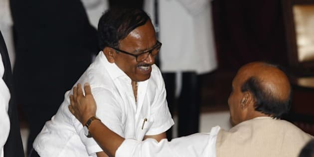 NEW DELHI, INDIA - NOVEMBER 9: Goa Chief Minister Laxmikant Parsekar (R) shake hands with Union Home Minister Rajnath Singh during the swearing-in ceremony of the new cabinet ministers at Rashtrapati Bhavan, on November 9, 2014 in New Delhi, India. With 21 new faces inducted into Prime Minister Narendra Modi Council of Ministers on Sunday, the strength of his team now stands at 66. This is the first expansion since Modi took oath with 45 ministers on May 26. (Photo by Arvind Yadav/Hindustan Times via Getty Images)
