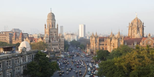 View over Victoria terminus or Chhatrapati Shivaji terminus (CST) and central Mumbai at dusk Mumbai India
