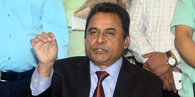 Mustafa Kamal (C), former president of the International Cricket Council, speaks to the media in Dhaka on April 1, 2015. Kamal resigned April 1 as president of the International Cricket Council, accusing colleagues within the game's global body of acting 'unlawfully'.  AFP PHOTO        (Photo credit should read STR/AFP/Getty Images)