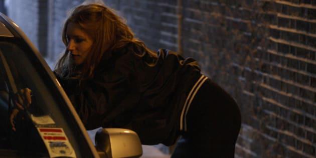 Street prostitute tempting a client