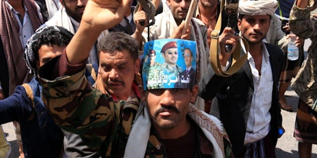 IBB, YEMEN - APRIL 01: Supporters of Shiite Houthi group march during a protest against Saudi-led operations in Yemen on April 01, 2015 in Ibb, Yemen. (Photo by Sinan Yiter/Anadolu Agency/Getty Images)