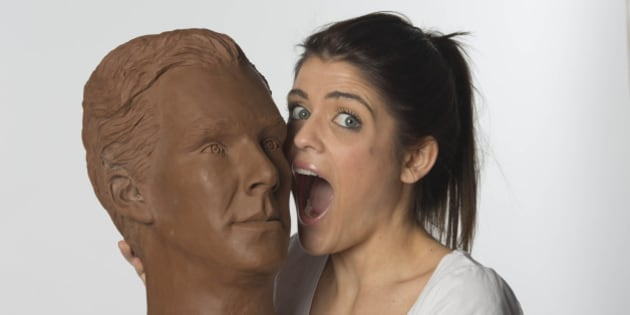 Clodagh Pickavance, 23, interacts with a life-size chocolate sculpture of actor Benedict Cumberbatch. The sculpture has been created to celebrate the launch of television channel Drama on the new on-demand service uktvplay.co.uk following a national poll which named Benedict as Britain's dishiest television drama actor, just in time for Easter. Picture date: Wednesday 1st April. A crew of eight people worked on the sculpture, which took over 250 man hours to create and weighs 40kg. The statue will be at Westfield Stratford on Friday 3rd April.