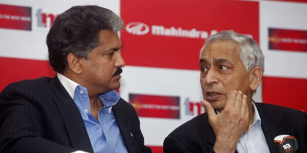 Mahindra Group Managing Director Anand Mahindra, left, and Tech Mahindra chief executive Vineet Nayyar talk during the announcement of the commencement of its special economic zone (SEZ) at the Mahindra Satyam infocity campus in Hyderabad, India, Tuesday, April 13, 2010. According to news reports, the SEZ is spread across 26 acres and have a built-up area of 400,000 square feet. The construction has already started. (AP Photo/Mahesh Kumar A)