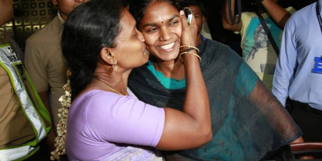 An Indian woman, left, greets her relative who arrived at Chhatrapati Shivaji International Airport in Mumbai, India, Thursday, April 2, 2015 after being evacuated from Yemen. India is evacuating its citizens from Yemen amid the growing violence in the Middle Eastern country. (AP Photo/Rafiq Maqbool)