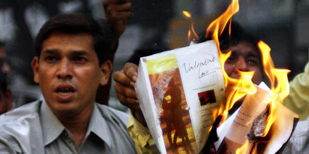 BOMBAY, INDIA:  Activists of hardline Hindu party, Shiv Sena, burn greeting cards in protest against Valentine's Day celebrations in Bombay, 13 February 2004.  Shiv Sena strongly opposes Valentine's Day celebrations calling it a cultural invasion on the Hindu way of life and annually burn love cards and even threatens shop keepers selling such Valentine products.  AFP PHOTO/Sebastian D'SOUZA  (Photo credit should read SEBASTIAN D'SOUZA/AFP/Getty Images)