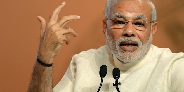 Indian Prime Minister Narendra Modi gestures as he speaks during the inauguration of a conference on Financial Inclusion in Mumbai on April 2, 2015.  The conference was organised on the occasion of completion of 80 years of the Reserve Bank of India (RBI). AFP PHOTO/PUNIT PARANJPE        (Photo credit should read PUNIT PARANJPE/AFP/Getty Images)
