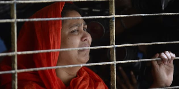 A relative of dead Bangladeshi blogger Washiqur Rahman reacts after seeing his body at Dhaka Medical College in Dhaka on March 30, 2015, after he was killed in an attack in the Bangladeshi capital. Police have arrested two men over the murder which comes just weeks after a US atheist blogger was also hacked to death in Dhaka, a crime that triggered international outrage, the officer said. AFP PHOTO/Munir uz ZAMAN        (Photo credit should read MUNIR UZ ZAMAN/AFP/Getty Images)