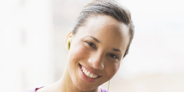 Portrait of female jogger with mp3 player