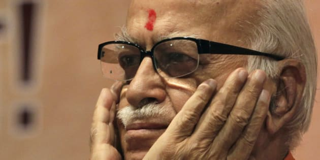 FILE – In this May 24, 2012 file photo, India's opposition Bharatiya Janata Party (BJP) senior leader Lal Krishna Advani gestures during the party's national executive meeting in Mumbai, India. Advani, a founding member of the rightwing BJP resigned from all party positions on June, 10, 2013, a day after the party appointed a controversial Hindu ideologue to lead its campaign in national elections next year. (AP Photo/ Rajanish Kakade, File)