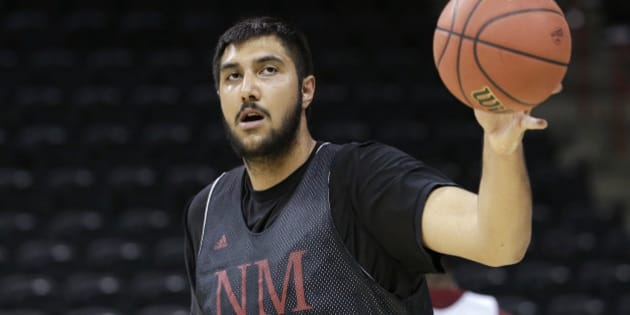 New Mexico State's Sim Bhullar reaches for a ball during practice for the NCAA college basketball tournament in Spokane, Wash., Wednesday, March 19, 2014. New Mexico State plays against San Diego State in a second-round game on Thursday. (AP Photo/Elaine Thompson)