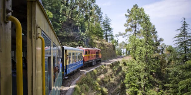 Train moving on railroad track in valley, Shimla, Himachal Pradesh, India. (Photo by: Exotica.im/UIG via Getty Images)