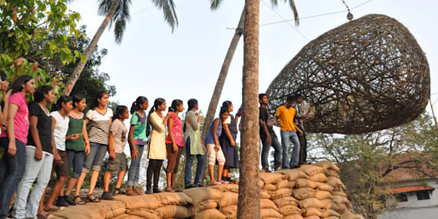 Visitors wait to see the installation work 'Erase' by Bangalore based artist Srinivasa prassad at the Kochi-Muziris Biennale 2012 exhibition in Kochi  on December 13, 2012. The Kochi-Muziris Biennale will span over 3 months from December 12, 2012 to March 13, 2013 and will feature the works of over 80 major artists from more than 24 countries. This is the first-ever biennale to be held in India. AFP Photo/ STR        (Photo credit should read STRDEL/AFP/Getty Images)