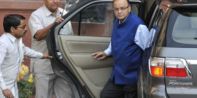 NEW DELHI, INDIA - FEBRUARY 28: Union Finance Minister Arun Jaitley arrives to presents the Budget 2015-16 in Parliament, that aims to ramp up growth, aided by a slowed pace of fiscal deficit cuts and a raft of tax measures to put private domestic and foreign capital to work, at North Block on February 28, 2015 in New Delhi, India. Jaitley promised higher investment in India's decrepit roads and railways, offered the carrot of corporate tax cuts to global corporations and the stick of tighter compliance rules to get Indian tycoons to invest at home rather than stash wealth abroad. He forecast inflation at 5% by the end of the fiscal year ending March 2016, undershooting the Reserve Bank of India's 6% target and creating room to cut interest rates. Annual inflation was 5.1% in January. He proposed to abolish the wealth tax and proposed two percent surcharge on the super rich. He said the government is proposing to rationalise various tax exemptions and incentives to reduce tax disputes and improve tax administration. (Photo by Mohd Zakir/Hindustan Times via Getty Images)