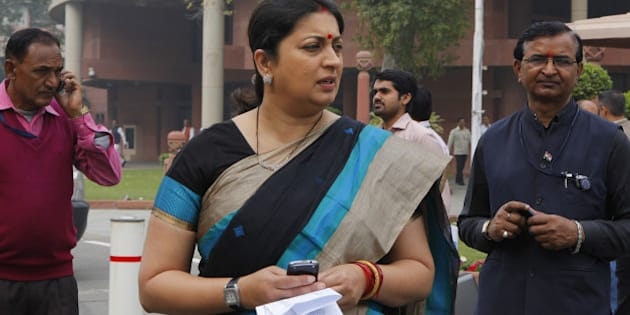 NEW DELHI, INDIA - FEBRUARY 24: Union HRD Minister Smriti Irani after BJP Parliamentary party meeting during Budget session at Parliament house on February 24, 2015 in New Delhi, India. The government introduced the land acquisition amendment bill in the Lok Sabha amid an uproar by the opposition. (Photo by Arvind Yadav/Hindustan Times via Getty Images)