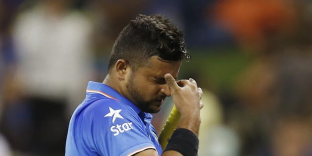 Indian batsman Suresh Raina reacts as he leaves the field after he was dismissed for 22 runs during their Cricket World Cup Pool B match against the West Indies in Perth, Australia, Friday, March 6, 2015. (AP Photo/Theron Kirkman)