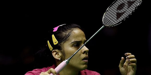Saina Nehwal of India prepares to play a point against China's Li Xuerui during their women's singles semi-final match at the 2015 Malaysia Open Badminton Superseries in Kuala Lumpur on April 4, 2015.    AFP PHOTO / MANAN VATSYAYANA        (Photo credit should read MANAN VATSYAYANA/AFP/Getty Images)