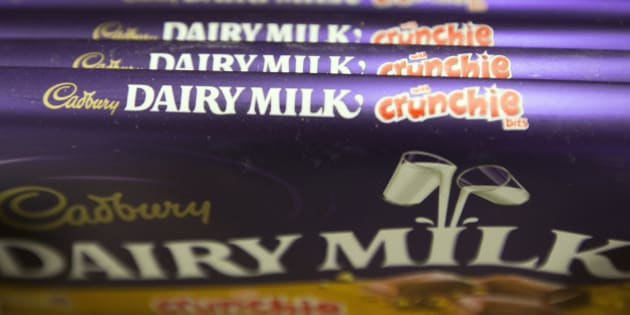 Bars of Cadbury 'Dairy Milk Crunchie' chocolate, manufactured by Kraft Foods Inc., sit displayed for sale inside an Asda supermarket, the U.K. retail arm of Wal-Mart Stores Inc., in Watford, U.K., on Thursday, Oct. 17, 2013. U.K. retail sales rose more than economists forecast in September as an increase in furniture demand led a rebound from a slump the previous month. Photographer: Simon Dawson/Bloomberg via Getty Images
