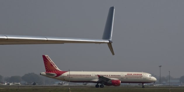 An Air India Airbus A321 taxis at Indira Gandhi international airport, in New Delhi, India,Wednesday, March 18, 2015. (AP Photo / Manish Swarup)