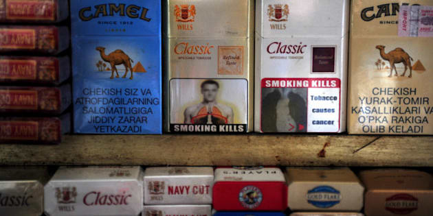 A packet of cigarettes (C), adorned with an image said to resemble that of Chelsea and England footballer John Terry, stands on a stall in New Delhi on January 3, 2012. Representatives of Chelsea captain John Terry have lodged a complaint over the apparent use of his image for a tobacco warning printed on cigarette packets in India, a report said. The blurry image that features the head and shoulders of a man resembling Terry above a warning that 'Smoking Kills' was created by the government agency the Directorate of Visual Publicity, the Indian Express reported.   AFP PHOTO/Findlay KEMBER (Photo credit should read FINDLAY KEMBER/AFP/Getty Images)