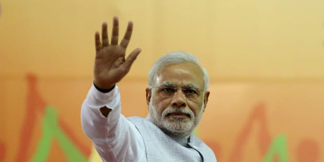 India's Prime Minister Narendra Modi waves to his supporters after addressing a rally organized by his party, the ruling Bharatiya Janata Party (BJP), in Bangalore, India, Friday, April 3, 2015. Modi's speech was mostly addressed to farmers on a day that President Pranab Mukherjee signed off on the latest version of the government's land acquisition ordinance, which proposes to ease rules for acquiring land to facilitate infrastructure projects, in a country where agriculture is the main livelihood of about 60 percent of the 1.2 billion people. (AP Photo/Aijaz Rahi)