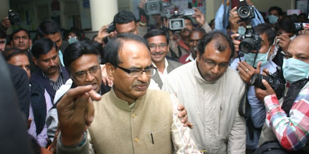 BHOPAL, INDIA - FEBRUARY 11: Madhya Pradesh Chief Minister Shivraj Singh Chouhan during his inspection of swine flu ward at JP hospital at district hospital on February 11, 2015 in Bhopal, India. As many as 216 people have lost their lives to Swine Flu across the country in the first ten days of February as the death toll due to the contagious disease mounted to 407 this year, mostly in states like Gujarat, Rajasthan and Madhya Pradesh. (Photo by Bidesh Manna/Hindustan Times via Getty Images)