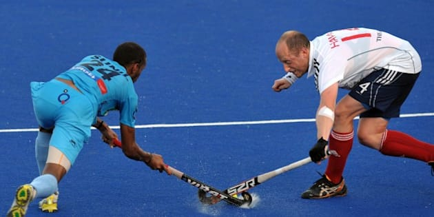 India's Vitalachharya Sunil Sowmarper (L) vies against Ben Hawes of Britain during a third place play-off match at the Sultan Azlan Shah Cup men's field hockey tournament in Malaysia's nothern town Ipoh of Perak state on June 3, 2012. India beat Britain 3-1. AFP PHOTO / Saeed Khan        (Photo credit should read SAEED KHAN/AFP/GettyImages)