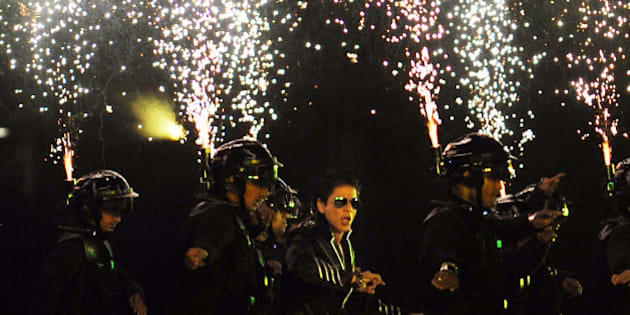 RESTRICTED TO EDITORIAL USE. MOBILE USE WITHIN NEWS PACKAGEBollywood actor Shah Rukh Khan (C) performs during the opening ceremony of the Indian Premier League (IPL) Twenty20 at The M.A. Chidambaram Stadium in Chennai on April 8, 2011. Defending champion Chennai Super Kings will face the chalenge of Kolkata Knight Riders in the first match of the tournament. AFP PHOTO/ Dibyangshu SARKAR (Photo credit should read DIBYANGSHU SARKAR/AFP/Getty Images)