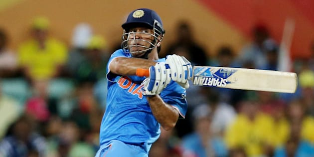 India's MS Dhoni plays a shot while batting against Australia during their Cricket World Cup semifinal in Sydney, Australia, Thursday, March 26, 2015. (AP Photo/Rick Rycroft)