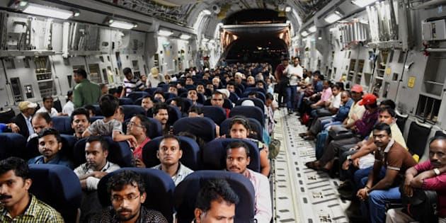Indians evacuated from Yemen sit inside the Indian Air Force C17 Globemaster aircraft upon their arrival at Chhatrapati Shivaji International Airport in Mumbai, India, Thursday, April 2, 2015. India is evacuating its citizens from Yemen amid the growing violence in the Middle Eastern country. (AP Photo/Press Trust of India, Mitesh Bhuvad)