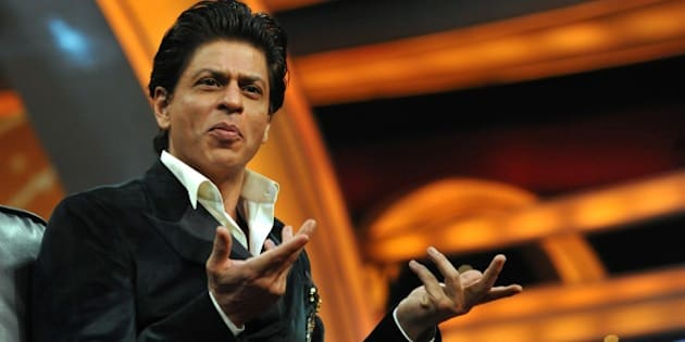 Indian Bollywood actor Shah Rukh Khan gestures during a press interaction to launch a new television show India Poochega  Sabse Shaana Kaun? in Mumbai on February 24, 2015.   AFP PHOTO/STR        (Photo credit should read STRDEL/AFP/Getty Images)