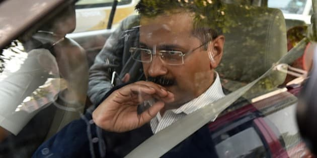 Aam Aadmi Party's Delhi chief minister-designate Arvind Kejriwal arrives for a meeting with Indian Home Minister Rajnath Singh in New Delhi on February 11, 2015, following his win in the Delhi Legislative Assembly election. India's Narendra Modi on February 10 suffered his first major election setback since becoming prime minister last May, as anti-corruption campaigner Arvind Kejriwal won a landslide victory in Delhi state polls. AFP PHOTO / MONEY SHARMA        (Photo credit should read MONEY SHARMA/AFP/Getty Images)