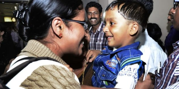 In this Saturday, April 4, 2015 photo, Indian nurse Tinu, left, one among the Indians evacuated from Yemen meets her son Febin upon her arrival in Kochi, India. India is evacuating its citizens from Yemen amid the growing violence in the Middle Eastern country. (AP Photo)