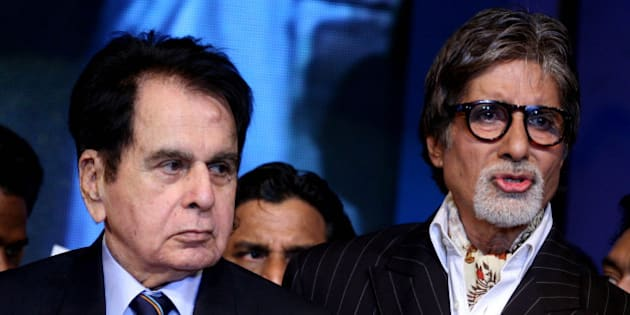 "Indian Bollywood actors Amitabh Bachchan (R) and Dilip Kumar (L) attend the ""143rd Dadasaheb  Phalke Academy Awards 2012"" ceremony, celebrating Indian Cinema  in Mumbai on 3 May, 2012. AFP PHOTO/ STR        (Photo credit should read STRDEL/AFP/GettyImages)"