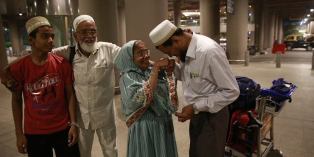An Indian Muslim man greets his mother after she arrived at Chhatrapati Shivaji International Airport in Mumbai, India, Monday April 6, 2015 after being evacuated from Yemen. India is evacuating its citizens from Yemen amid the growing violence in the Middle Eastern country. (AP Photo/Rafiq Maqbool)